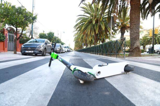 Scooter lying in the middle of the road after accident